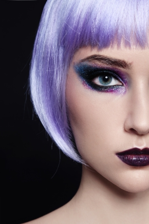 Close-up portrait of young beautiful girl in violet wig photo