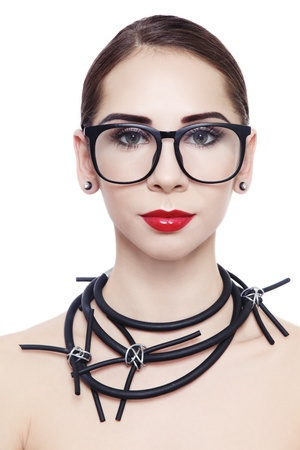 Portrait of young attractive woman in hipster glasses and fancy necklace, on white background photo