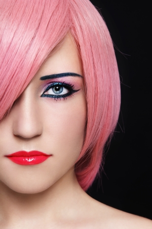 Close-up portrait of young beautiful woman in pink wig photo