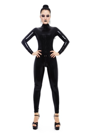 latex woman: Young beautiful slim woman in black latex catsuit, over white background