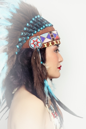 indian headdress: Young woman in costume of American Indian Stock Photo