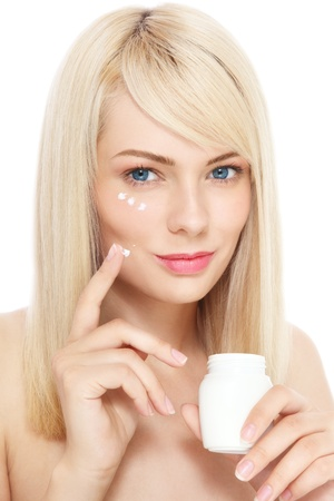 radicals: Portrait of young fresh beautiful healthy woman applying cream on her face, over white background