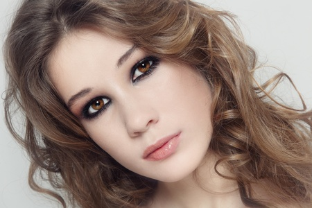 smoky eyes: Young beautiful fresh girl with curly hair and smoky eyes