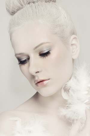 Portrait of young beautiful woman with powdered vintage hairdo and white feather boa Stock Photo - 19550198