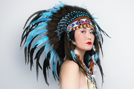 warrior tribal: Young woman in costume of American Indian Stock Photo