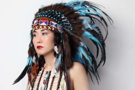 faceart: Young woman in costume of American Indian Stock Photo