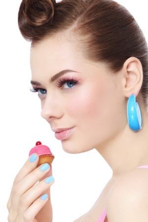 Portrait of young beautiful woman with petit four pastry in her hand, over white background Stock Photo - 19550222