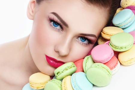 guilty pleasure: Close-up portrait of young beautiful woman with colorful macaroons
