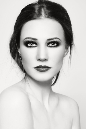 smoky eyes: Black and white portrait of young beautiful woman with smoky eyes