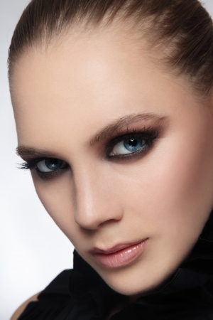 smoky eyes: Close-up portrait of beautiful stylish young woman with smoky eyes