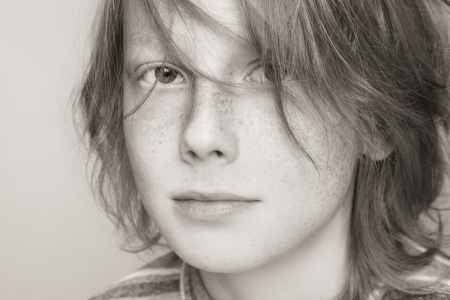 freckled: Close-up duotone portrait of freckled teen boy