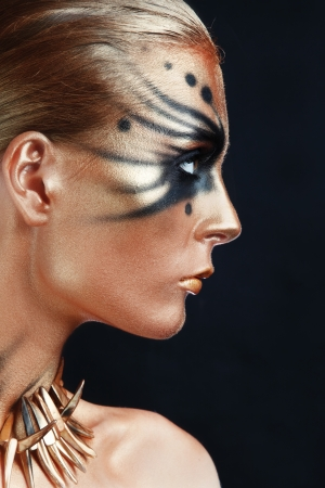 faceart: Profile portrait of young beautiful woman with face-art Stock Photo
