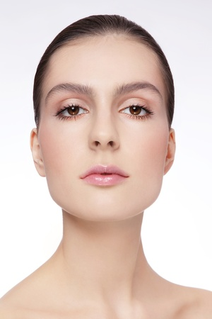 Portrait of young beautiful woman with clear make-up