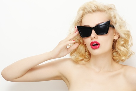 Young beautiful stylish blond woman in vintage sunglasses Stock Photo
