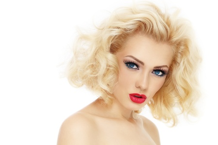 dry hair: Young beautiful woman with blond curly hair and stylish make-up, over white background Stock Photo