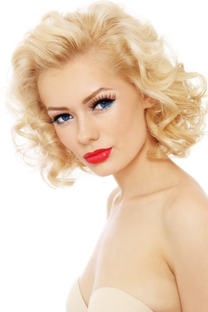 Young beautiful sexy blonde with stylish make-up and hairdo over white background photo