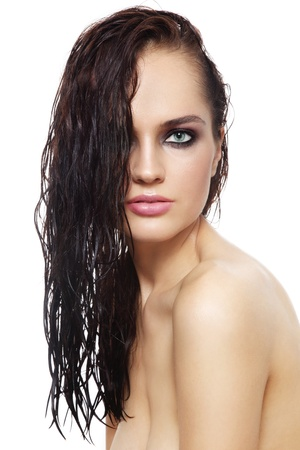 Young beautiful woman with long wet hair over white background photo
