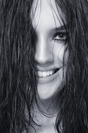 Duotone close-up portrait of young beautiful sexy smiling woman with wet hair photo