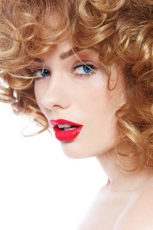 Portrait of young beautiful woman with curly hair and red lipstick over white background photo