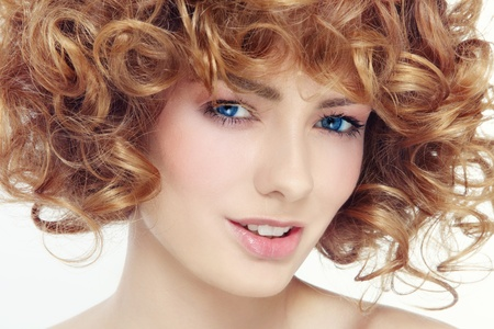 permanent wave: Portrait of young beautiful happy smiling woman with curly hair  Stock Photo