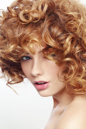 perming: Portrait of young beautiful woman with curly hair