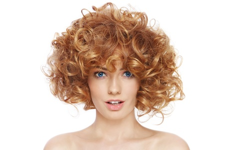 perming: Young beautiful happy sexy woman with curly hair over white background