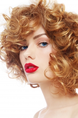 Portrait of young beautiful woman with curly hair and red lipstick over white background