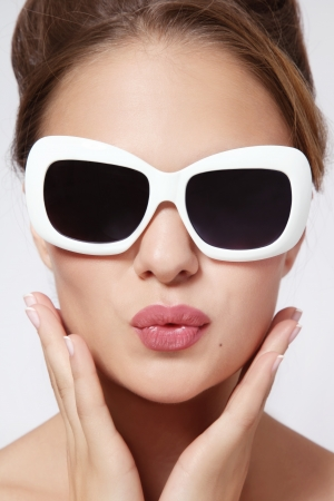 Portrait of young beautiful woman in vintage sunglasses photo