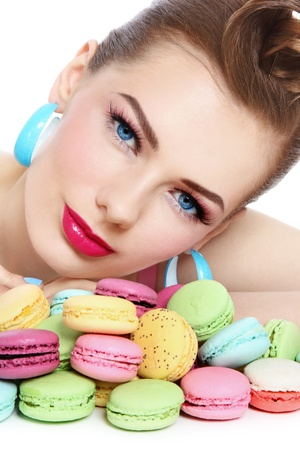 Portrait of young beautiful woman with colorful macaroons photo