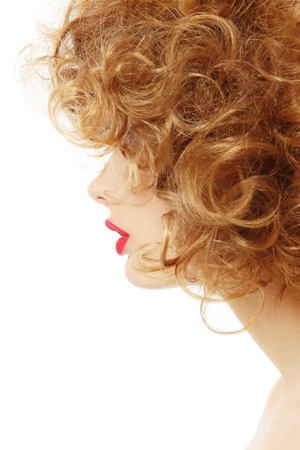 perming: Profile of young beautiful sexy woman with curly hair, over white background