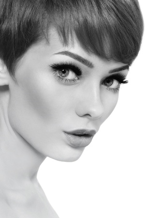 Black and white portrait of young beautiful woman with stylish short haircut over white background Stock Photo - 21890315