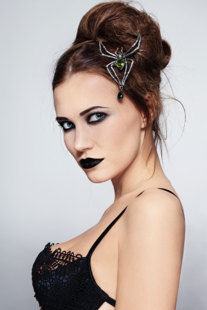 succubus: Portrait of young beautiful sexy woman with black lipstick and stylish hairdo Stock Photo