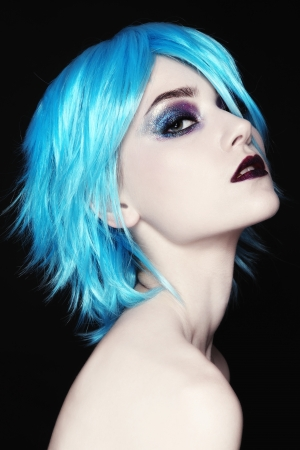 Portrait of young beautiful girl in fancy blue wig photo
