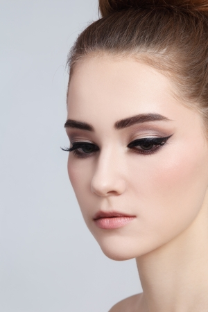 Portrait of young beautiful girl with cat eye make-up photo