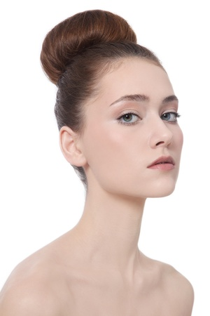 Young beautiful slim girl with hair bun over white background Stock Photo