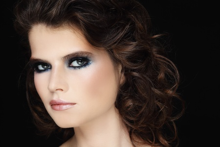 permanent wave: Portrait of young beautiful woman with stylish make-up and long curly hair