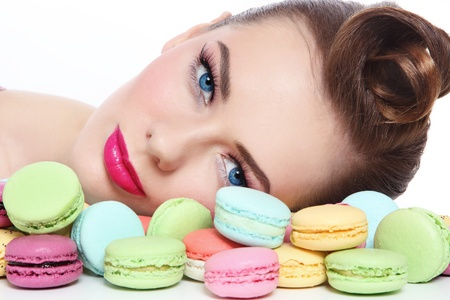 unhealthy eating: Portrait of young beautiful woman with colorful macaroons