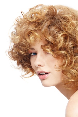 perming: Portrait of young beautiful woman with curly hair over white background