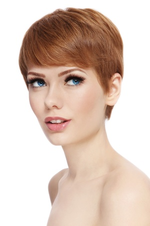 short haircut: Portrait of young beautiful woman with stylish short haircut looking upwards, over white background Stock Photo