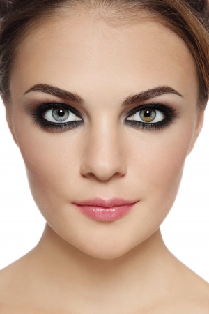 Close-up portrait of young beautiful stylish woman with smoky eyes over white background Stock Photo