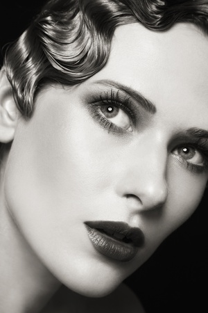 undulation: Close-up duotone portrait of young beautiful woman with stylish make-up and retro hairdo