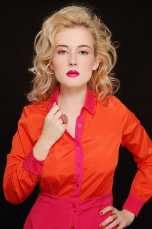 permanent wave: Young beautiful stylish woman with long curly blond hair and fancy