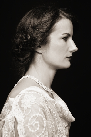 Profile portrait of beautiful mature lady in vintage dress photo