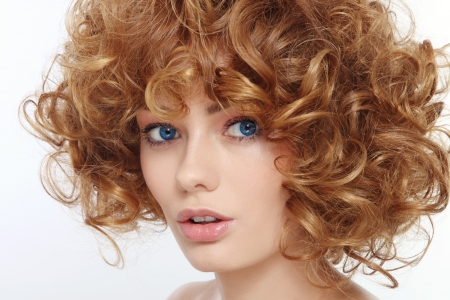 perming: Close-up portrait of young beautiful woman with curly hair  Stock Photo