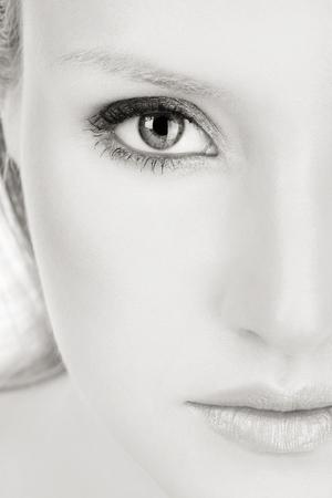 Close-up duotone portrait of young beautiful woman  photo
