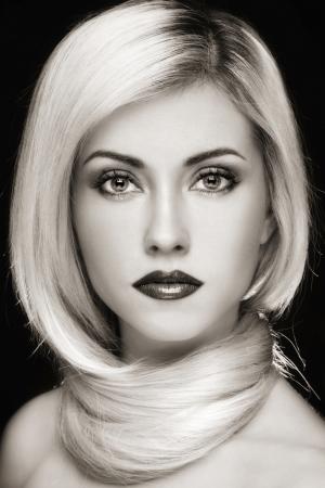 Duotone portrait of young beautiful blond woman with stylish make-up