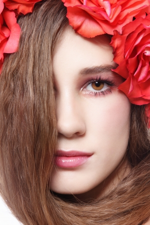 permanent wave: Close-up portrait of young beautiful fresh girl with long hair and floral headband Stock Photo