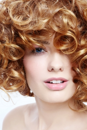 permanent wave: Close-up portrait of young beautiful sexy woman with curly hair
