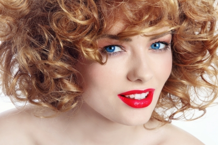 permanent wave: Portrait of young beautiful happy smiling woman with curly hair and red lipstick
