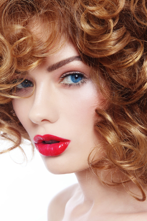perming: Portrait of young beautiful woman with red lipstick